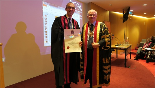 Dr Iain Moppett receiving the Macintosh Professorship from Dr Liam Brennan